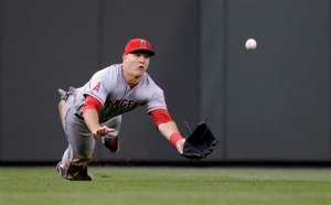 Los Angeles Angels center fielder Mike Trout dives for a fly ball against the Seattle Mariners in a baseball game Thursday, May 29, 2014, in Seattle. (AP Photo/Elaine Thompson)